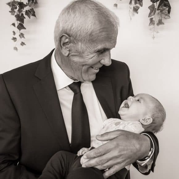 funeral photography - a grandfather playing with his grandson at a Croatian funeral